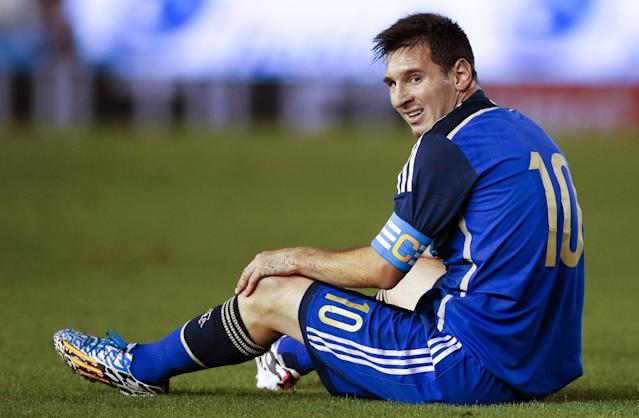 Argentina's Lionel Messi sits on the grass during an international friendly soccer match against Trinidad and Tobago in Buenos Aires, Argentina, Wednesday, June 4, 2014. (AP Photo/Natacha Pisarenko)