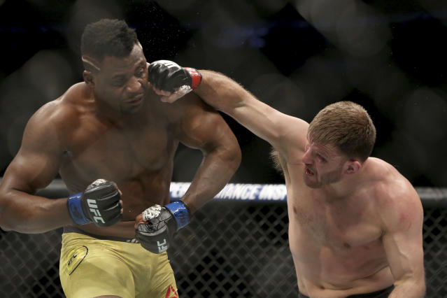 Stipe Miocic lands a right hand against Francis Ngannou during a heavyweight championship mixed martial arts bout at UFC 220. (AP)