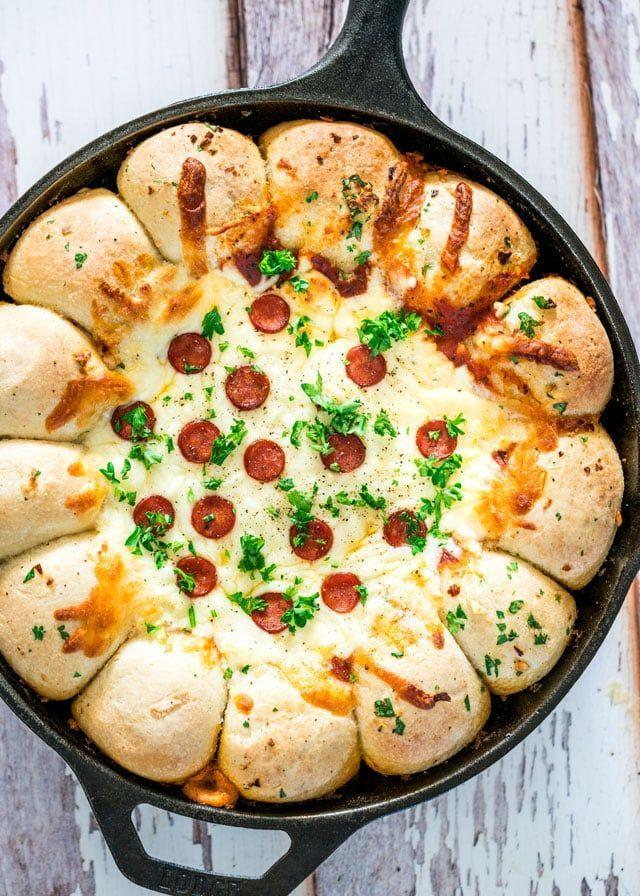 "<p>Your guests will be fighting over the last bite of this cheesy skillet.</p><p><strong>Get the recipe at <a href=""https://www.jocooks.com/recipes/skillet-pizza-dip/"" rel=""nofollow noopener"" target=""_blank"" data-ylk=""slk:Jo Cooks"" class=""link rapid-noclick-resp"">Jo Cooks</a>.</strong></p>"