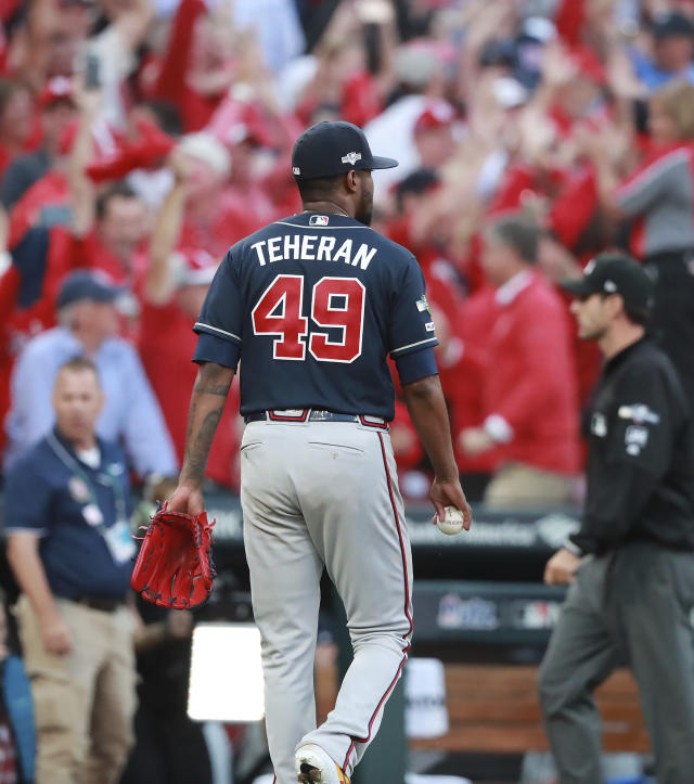 Atlanta Braves pitcher Julio Teheran walks off the field after giving up a winning sacrifice fly to St. Louis Cardinals' Yadier Molina to score Kolten Wong during the 10th inning of Game 4 of a baseball National League Division Series, Monday, Oct. 7, 2019, in St. Louis. (Curtis Compton/Atlanta Journal-Constitution via AP)