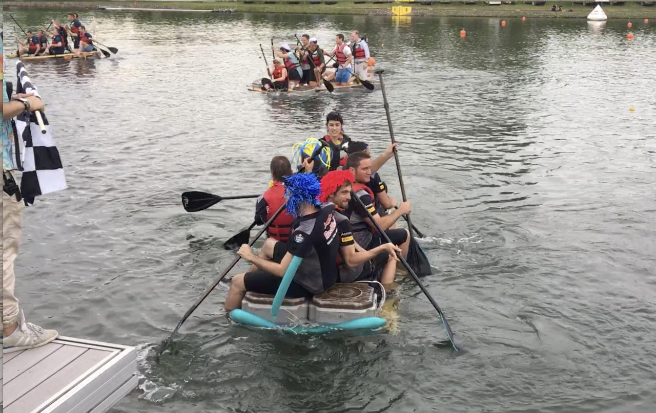 In this image from video, teams compete in the raft race, after qualifications for the Formula 1 Canadian Grand Prix in Montreal, June 10, 2017. Just hours before strapping rock star drivers into multimillion-dollar cars traveling at more than 200 mph, team crews--and executives--traded their firesuits for life preservers in a beer-soaked beach party on the erstwhile Olympic rowing venue next to the Circuit Giles Villeneuve. (AP Photo/Jimmy Golen)