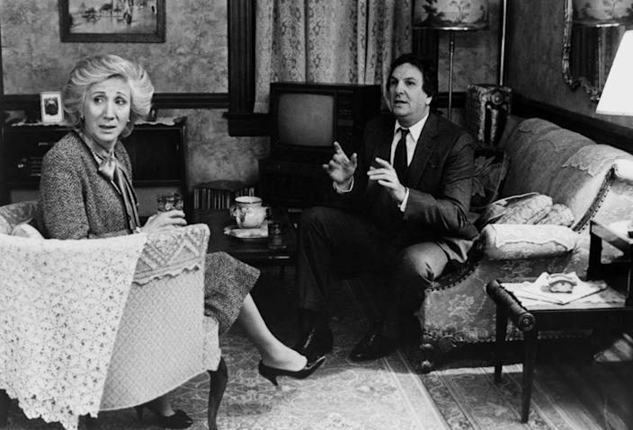 """Olympia Dukakis and Danny Aiello sit in a living room in a scene from 1987's """"Moonstruck."""""""
