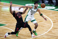 Boston Celtics forward Jayson Tatum (0) pushes off Toronto Raptors guard Norman Powell (24) while chasing the ball during the first half of an NBA basketball game, Thursday, March 4, 2021, in Boston. (AP Photo/Charles Krupa)