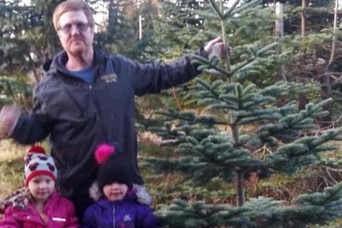 47-year-old Corey Simmons with his four-year-old twins who survived a car crash which killed him.