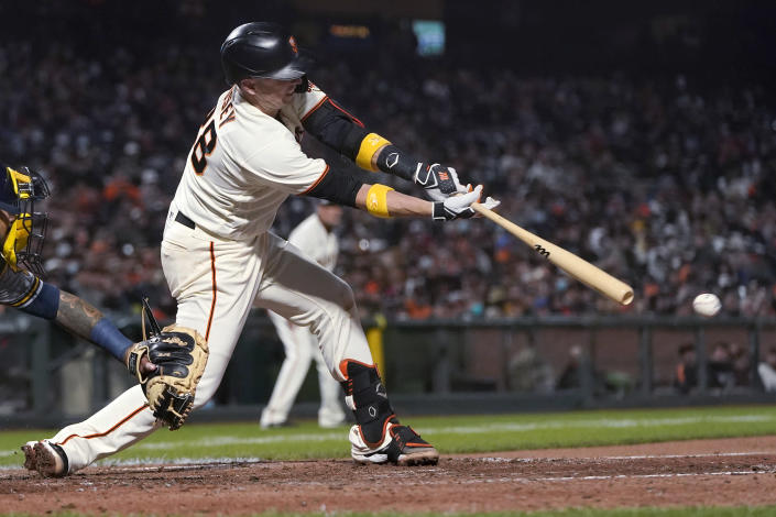San Francisco Giants' Buster Posey hits an RBI single against the Milwaukee Brewers during the fifth inning of a baseball game in San Francisco, Wednesday, Sept. 1, 2021. (AP Photo/Jeff Chiu)