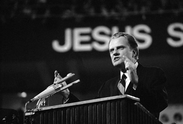<p>Billy Graham preaches a sermon in Dortmund'€™s Westfalen-Halle on April 5, 1970, at the start of an eight-day crusade broadcast throughout Europe via closed television circuit, in 35 cities and 10 countries. (Photo: Hinniger/AP) </p>