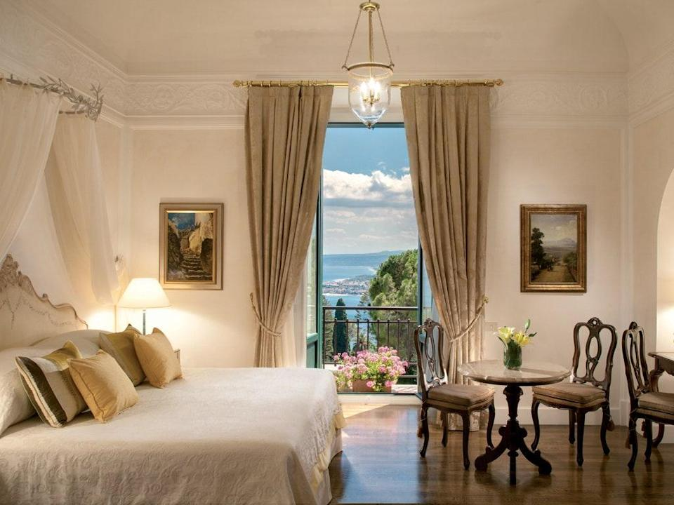 The first hotel in Taormina, Belmond Grand Hotel Timeo still dazzles guests with views and history that have been here for more than a century. The hotel overlooks the terra-cotta rooftops of the medieval village and, beyond that, the coast toward Mount Etna. In the foreground, there are manicured gardens, unapologetically opulent guest rooms, and a wellness center with a focus on natural, organic products with healing local herbs and neroli oil. The Literary Terrace was frequented by the likes of D.H. Lawrence, Truman Capote, and Tennessee Williams, and inside, the 16-seat Otto Geleng restaurant holds a Michelin star.