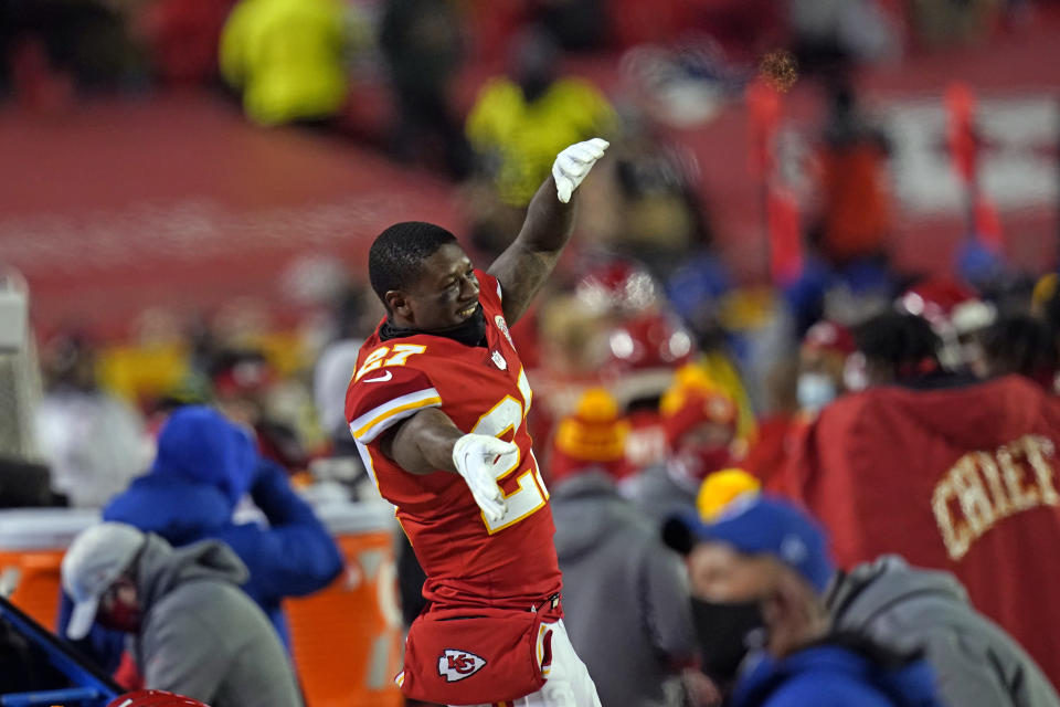Kansas City Chiefs cornerback Rashad Fenton celebrates on the bench during the second half of the AFC championship NFL football game against the Buffalo Bills, Sunday, Jan. 24, 2021, in Kansas City, Mo. (AP Photo/Orlin Wagner)