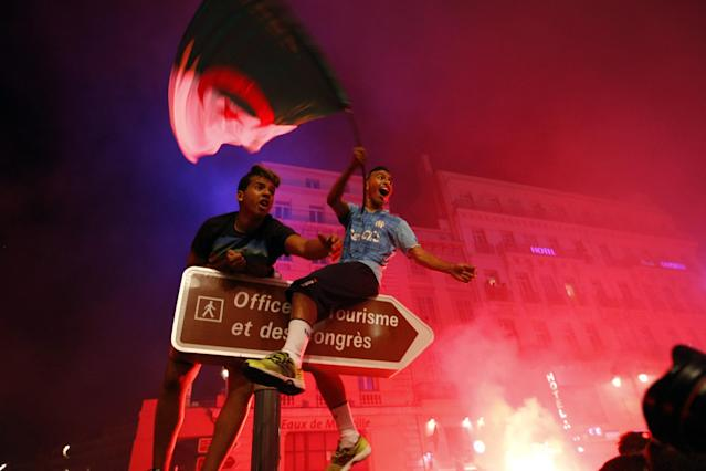 Algerian soccer fans celebrate after their team qualified for the World Cup, in Marseille, southern France, Thursday, June 26, 2014. Algeria drew with Russia 1-1, and advanced to the round of 16 for the first time in their World Cup history. (AP Photo/Claude Paris)