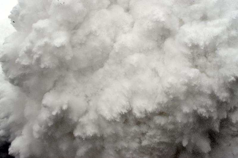A cloud of snow and debris is captured April 25, 2015, just before it flattened part of Everest Base Camp in the Himalayas, where a killer snowstorm was among weather events worsened by climate change, according to a study released November 5, 2015 (AFP Photo/Roberto Schmidt)