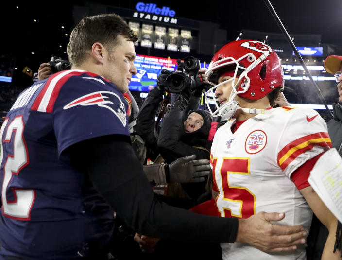 Tom Brady shakes hands with Patrick Mahomes after a 2019 regular-season game between the Patriots and Chiefs. (Photo by Matthew J. Lee/The Boston Globe via Getty Images)