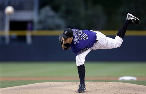 Colorado Rockies starter Jeff Francis follows through on a pitch during the first inning baseball game against the Los Dodgers in Denver on Monday, Aug. 27, 2012. (AP Photo/Joe Mahoney)