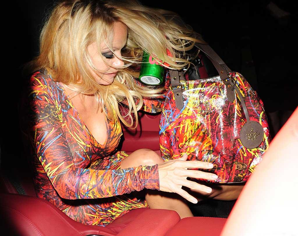 """Pammy hopped into her ride home clutching her bag and her complimentary Vivienne Westwood-designed SIGG water bottle. Tony Clark/<a href=""""http://www.splashnewsonline.com/"""" target=""""new"""">Splash News</a> - September 19, 2010"""