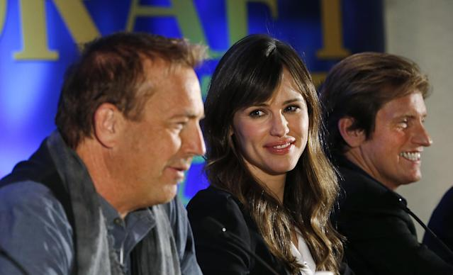 "Actors, from left, Kevin Costner, Jennifer Garner and Denis Leary appear at a news conference for the movie ""Draft Day"" in New York on Friday, Jan. 31, 2014. The Seattle Seahawks play the Denver Broncos on Sunday at the stadium in the NFL Super Bowl XLVIII football game. (AP Photo/Paul Sancya)"