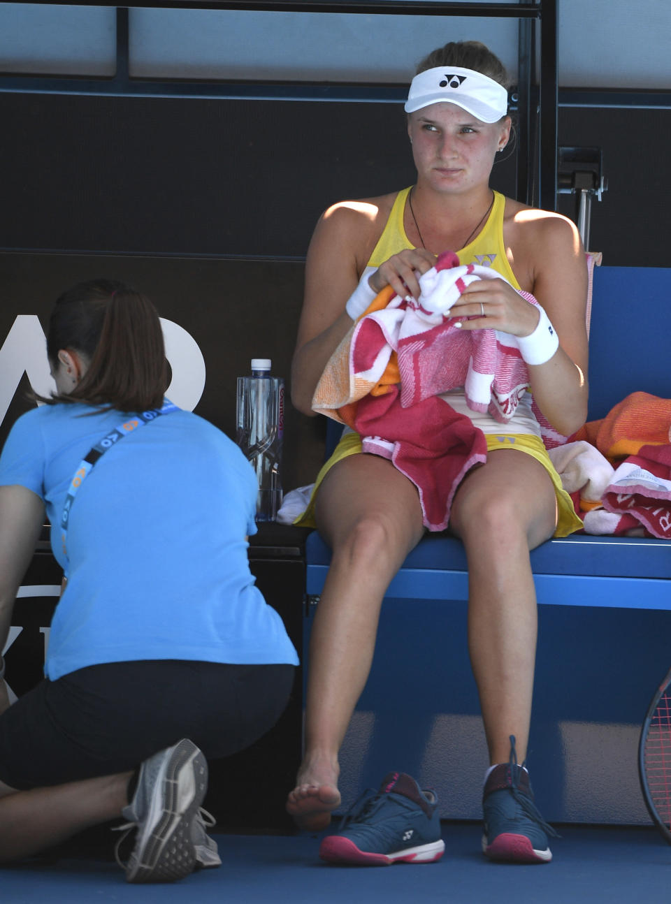 Ukraine's Dayana Yastremska waits to receive treatment to a foot injury during her third round match against United States' Serena Williams at the Australian Open tennis championships in Melbourne, Australia, Saturday, Jan. 19, 2019. (AP Photo/Andy Brownbill)