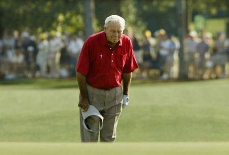 Arnold Palmer pauses and bows to the gallery as he walks to the 18th green during his final competitive appearance in the Masters golf tournament at Augusta National Golf Club in Augusta