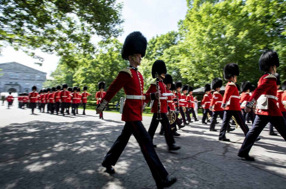 Members of the Ceremonial Guard march past Rideau Hall