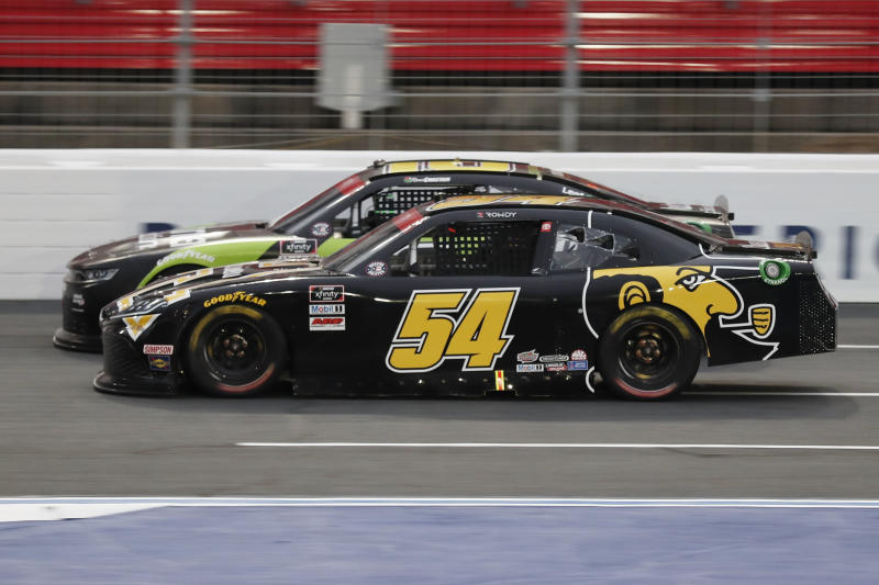 Kyle Busch (54) and Ross Chastain (10) battle during a NASCAR Xfinity Series auto race at Charlotte Motor Speedway Monday, May 25, 2020, in Concord, N.C. (AP Photo/Gerry Broome)