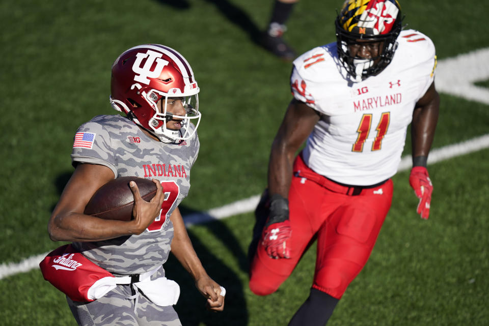 Indiana quarterback Michael Penix Jr. (9) is chased by Maryland's Ruben Hyppolite II (11) during the second half of an NCAA college football game, Saturday, Nov. 28, 2020, in Bloomington, Ind. Indiana won 27-11. (AP Photo/Darron Cummings)