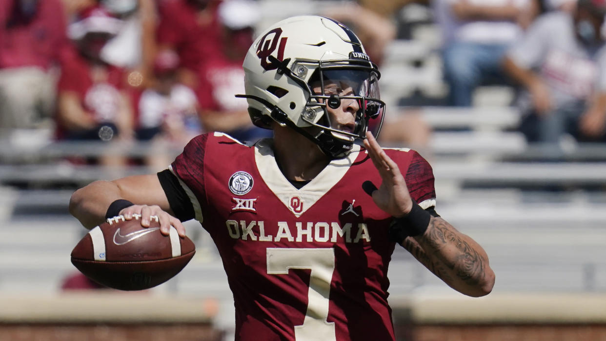 Oklahoma quarterback Spencer Rattler (7) passes in the second half of an NCAA college football game against Kansas State Saturday, Sept. 26, 2020, in Norman, Okla. (AP Photo/Sue Ogrocki).