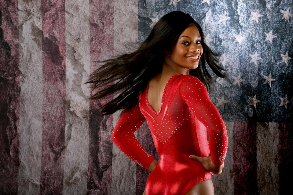 <p>Joining Team USA for the second time in the Olympic Games along with Raisman, Gabrielle 'Gabby' Douglas made history in the last Games as the first African-American gymnast to win all-around gold. (Getty) </p>