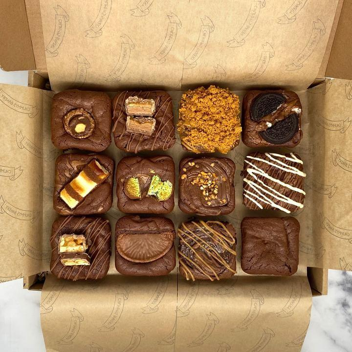 "<p>These postal brownies are beyond adorable! And perfectly bite-sized to make the best afternoon snack. </p><p><a class=""link rapid-noclick-resp"" href=""https://chummysbakery.co.uk/products/mixed-postal-brownie-box?variant=31755620778118¤cy=GBP&gclid=CjwKCAiA17P9BRB2EiwAMvwNyLt9YtVqevMFJ8RD9TwNB2gAWHu9opX5lI3fKYnI-y1bGnN1DPacahoCrzYQAvD_BwE"" rel=""nofollow noopener"" target=""_blank"" data-ylk=""slk:BUY NOW"">BUY NOW</a> <strong>£14.99</strong></p>"