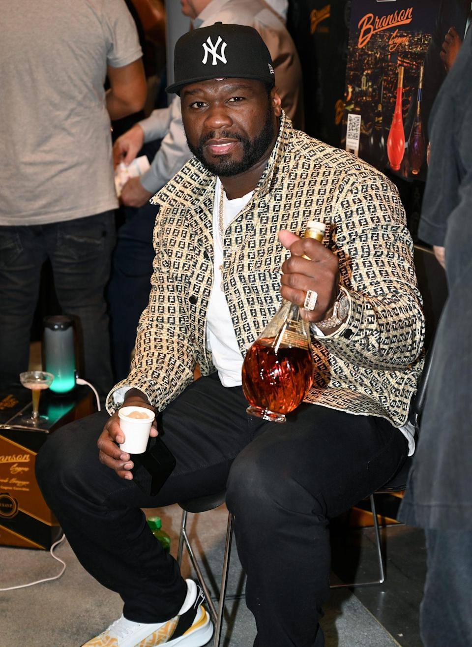 <p>50 Cent poses at the Branson Cognac booth during day 2 of the 35th Annual Nightclub & Bar Show and World Tea Expo at the Las Vegas Convention Center on June 29.</p>
