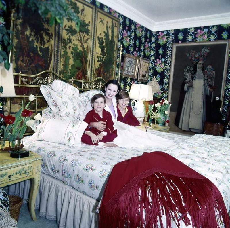 Gloria Vanderbilt and her two sons, Anderson and Carter, sit on her bed. (Photo by Horst P. Horst/Condé Nast via Getty Images)