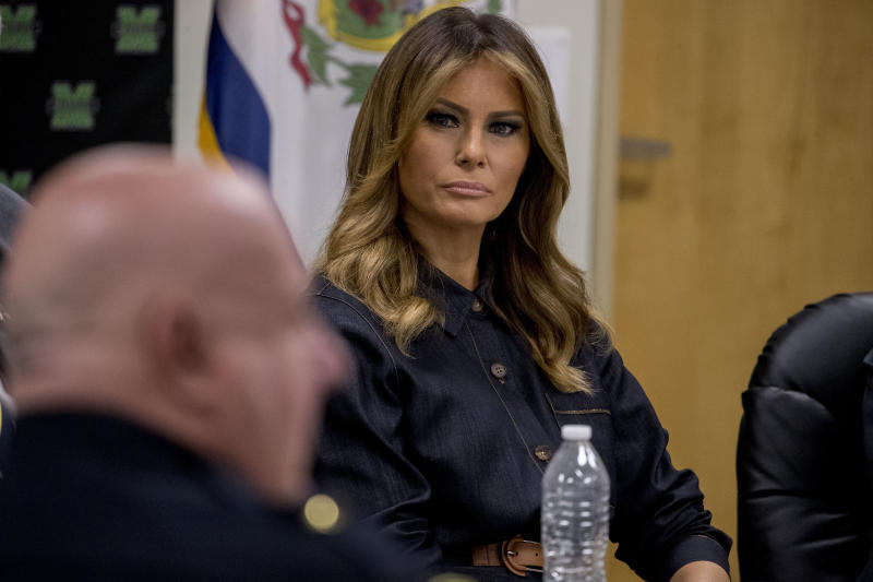 First lady Melania Trump, center, listens as Huntington Police Chief Hank Dial, foreground, speaks during a roundtable on the opioid epidemic at Cabell-Huntington Health Center in Huntington, WVa., Monday, July 8, 2019. (AP Photo/Andrew Harnik)