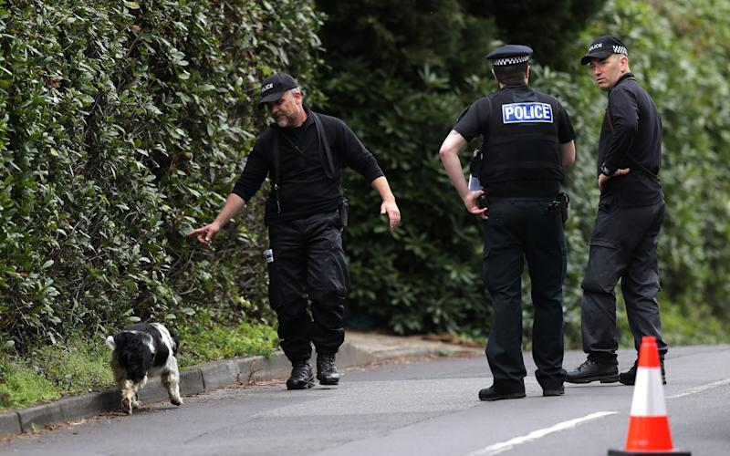 A Police search dog on David's Lane in St Ives, Ringwood, near to where Guy Hedger was gunned down by intruders at a house in East Dorset - Credit: PA