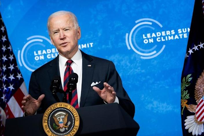 US President Joe Biden speaks during the climate change virtual summit from the East Room of the White House