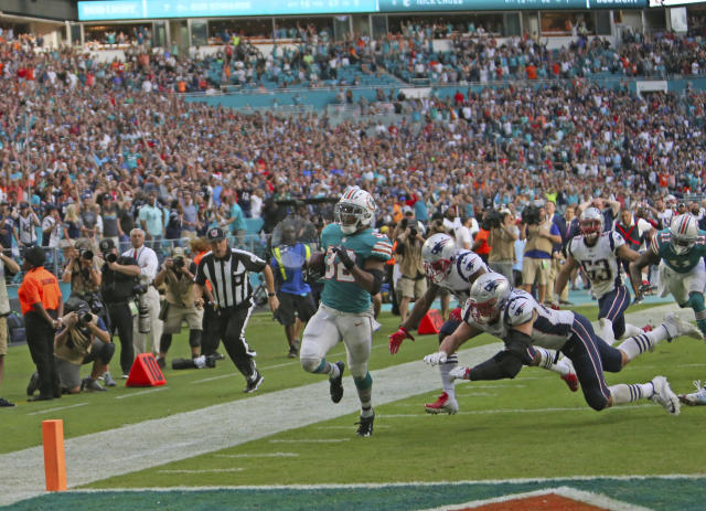 Dolphins running back Kenyan Drake scored a memorable game-winning touchdown against the Patriots, then threw the ball in the crowd. (AP)