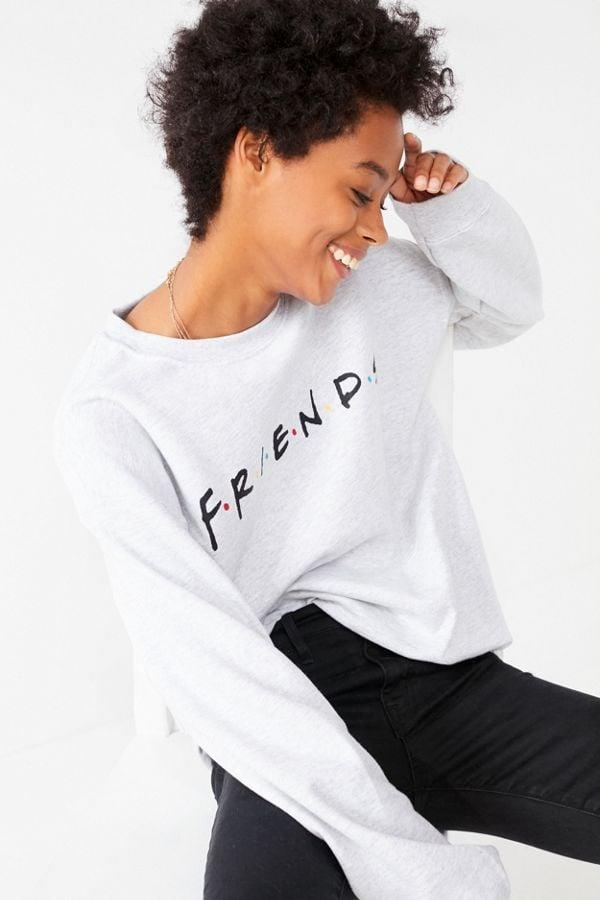 """<p>You'll feel like you're at Central Perk when you wear this <a href=""""https://www.popsugar.com/buy/Logo-Crew-Neck-Sweatshirt-438993?p_name=Logo%20Crew-Neck%20Sweatshirt&retailer=urbanoutfitters.com&pid=438993&price=49&evar1=buzz%3Aus&evar9=44164386&evar98=https%3A%2F%2Fwww.popsugar.com%2Fentertainment%2Fphoto-gallery%2F44164386%2Fimage%2F46069639%2FLogo-Crew-Neck-Sweatshirt&list1=tv%2Cfriends%2Cgift%20guide%2Cnostalgia%2Centertainment%20gifts&prop13=api&pdata=1"""" rel=""""nofollow"""" data-shoppable-link=""""1"""" target=""""_blank"""" class=""""ga-track"""" data-ga-category=""""Related"""" data-ga-label=""""https://www.urbanoutfitters.com/shop/friends-logo-crew-neck-sweatshirt?category=SEARCHRESULTS&amp;color=004"""" data-ga-action=""""In-Line Links"""">Logo Crew-Neck Sweatshirt</a> ($49).</p>"""
