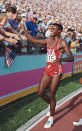 LOS ANGELES, CA - AUG 6 1984: Carl Lewis of the USA celebrates his gold medal win in the Long Jump final during the 1984 Olympic Games. Lewis won the gold medal with a jump of 8. 54 metres at the Colliseum Stadium on August 6, 1984 in Los Angeles. (Photo by Tony Duffy / Getty Images )