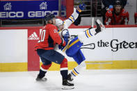 Washington Capitals center Lars Eller (20) battles with Buffalo Sabres center Curtis Lazar, right, during the third period of an NHL hockey game, Friday, Jan. 22, 2021, in Washington. (AP Photo/Nick Wass)