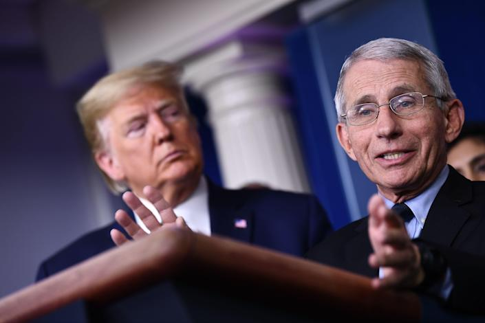 Dr. Anthony Fauci speaks as US President Donald Trump listens during the daily press briefing on the Coronavirus pandemic situation at the White House on March 17, 2020 in Washington, DC. (Photo: BRENDAN SMIALOWSKI/AFP via Getty Images)