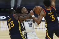 Memphis Grizzlies' Ja Morant, center, shoots against Golden State Warriors' Draymond Green, left, and Jordan Poole during the second half of an NBA basketball Western Conference play-in game in San Francisco, Friday, May 21, 2021. (AP Photo/Jed Jacobsohn)