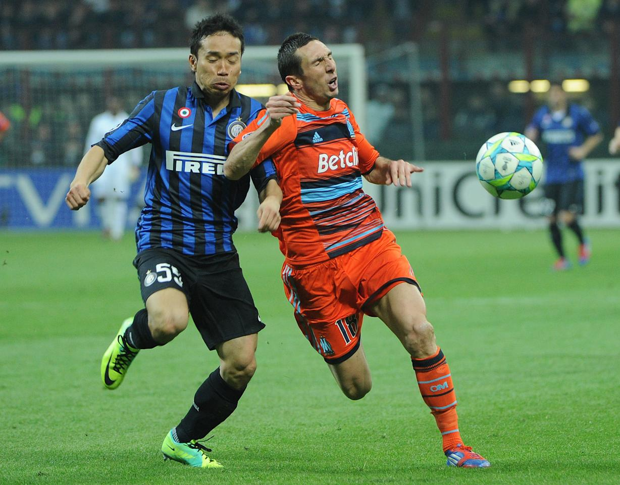 Inter Milan's Japanese  midfielder Yuto Nagatomo (L) fights for the ball with  Marseille's midfielder Morgan Amalfitano during their second leg Champions League round of 16 football match in Milan's San Siro Stadium on March 13, 2012.  AFP PHOTO / OLIVIER MORIN (Photo credit should read OLIVIER MORIN/AFP/Getty Images)