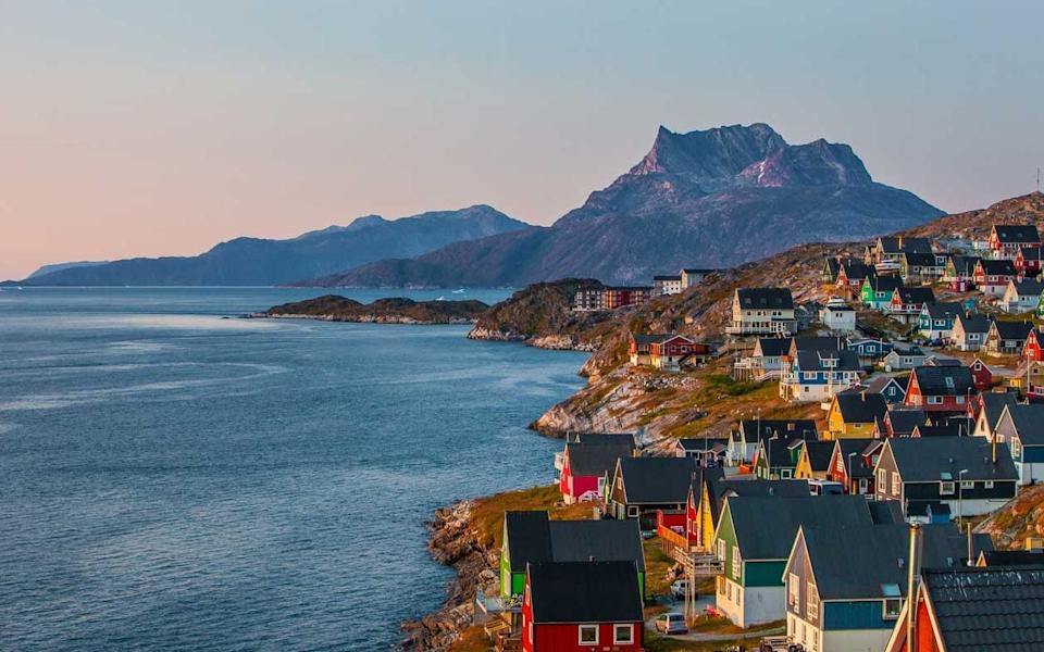 Colorfull houses at sunset in the capital of Greenland - iStock