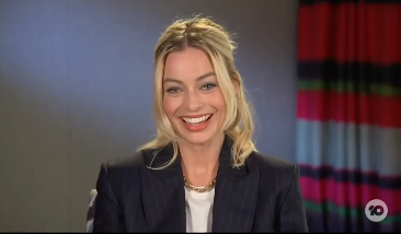 Margot Robbie laughing during an interview on The Project