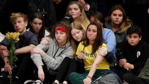 PHOTO: Young people console each other during a community vigil to honor the victims and survivors of a fatal shooting at the STEM School Highlands Ranch, late Wednesday, May 8, 2019, in Highlands Ranch, Colo. (David Zalubowski/AP)