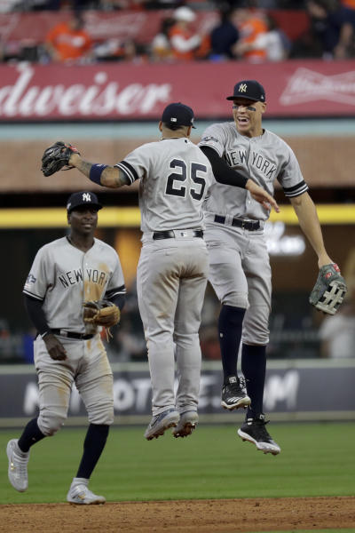 New York Yankees second baseman Gleyber Torres (25), and right fielder Aaron Judge celebrate after their win against the Houston Astros in Game 1 of baseball's American League Championship Series Saturday, Oct. 12, 2019, in Houston.(AP Photo/Eric Gay)