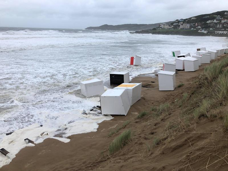 Several beach huts being washed into the sea as heavy winds battered Britain. See SWNS story SWPLhuts SWPLhuts; The huts washed into the sea at Woolacombe beach last night (Thurs) and were still bobbing around with the waves this morning 21 Aug 2020. Local resident Richard Walden said it was a scene of devastation. His pictures were taken as Britain woke up to the carnage caused by the arrival of Storm Ellen. The Met Office predicted wind gusts reaching speeds of over 50mph in places.