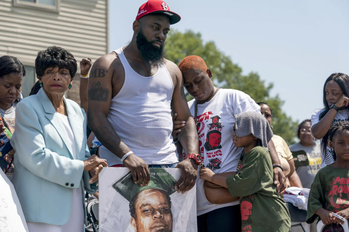 Michael Brown Sr., center, with his family on the fifth anniversary of the death of his son, Michael Brown, Ferguson, Mo., on Aug. 9, 2019.  (Whitney Curtis/The New York Times)