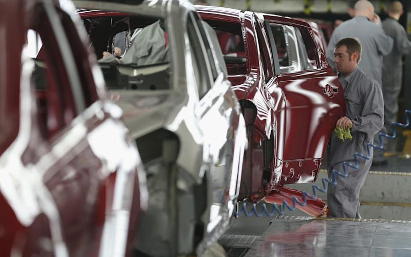 A worker on Nissan's production line at the company's giant Sunderland plant - Getty Images Europe