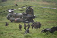 French army soldiers walk from a Chinook helicopter during a joint military drill between Japan Self-Defense Force, French army and U.S. Marines, at the Kirishima exercise area in Ebino, Miyazaki prefecture, southern Japan Saturday, May 15, 2021. (Charly Triballeau/Pool Photo via AP)