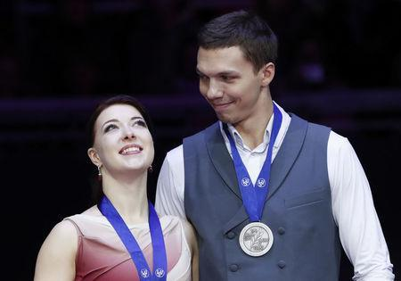 Figure Skating - ISU European Championships 2018 - Ice Dance Victory Ceremony - Moscow, Russia - January 20, 2018 - Silver medallists Ekaterina Bobrova and Dmitri Soloviev of Russia attend the ceremony. REUTERS/Grigory Dukor
