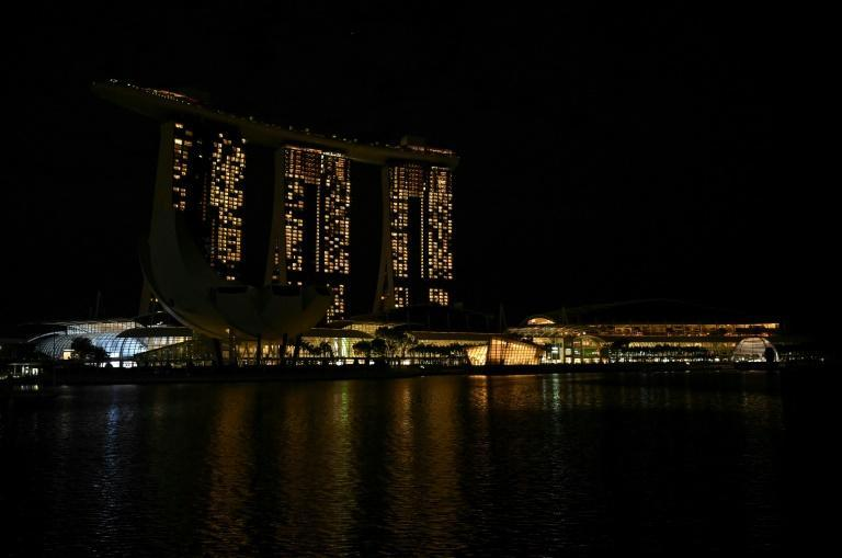 """Earth Hour is about """"more than just saving energy, it's more like remembering our impact on the environment,"""" Ian Tan in Singapore said"""
