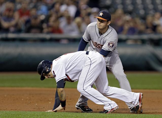 Houston Astros third baseman Brandon Laird, top, tags out Cleveland Indians' Asdrubal Cabrera between second and third on a ground ball by Mike Aviles to drive in a run in the second inning of a baseball game on Friday, Sept. 20, 2013, in Cleveland. (AP Photo/Mark Duncan)