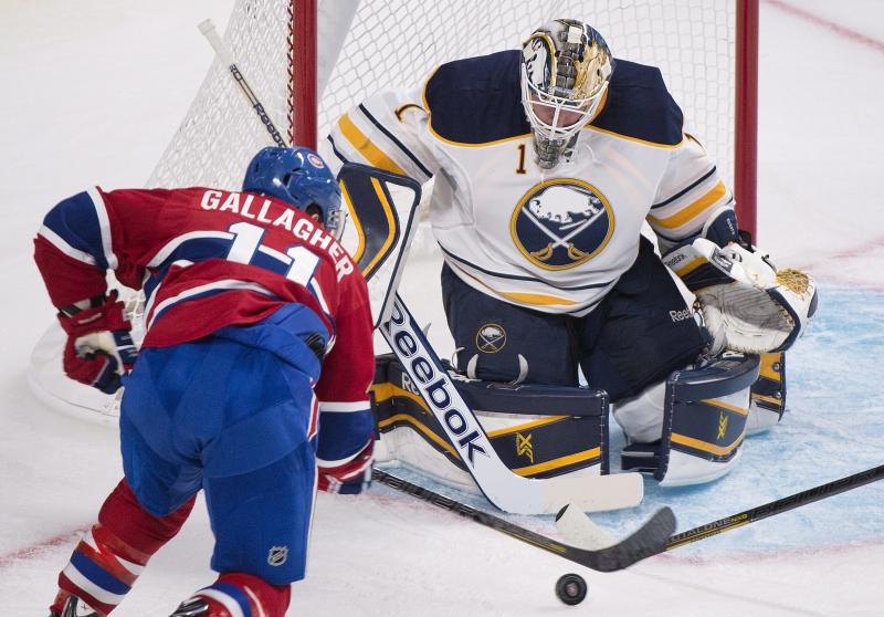 Buffalo Sabres' goaltender Jhonas Enroth, right, makes a save against Montreal Canadiens' Brendan Gallagher during the first period of an NHL pre-season hockey game, Sunday, Sept. 15, 2013 in Montreal. (AP Photo/The Canadian Press, Graham Hughes)